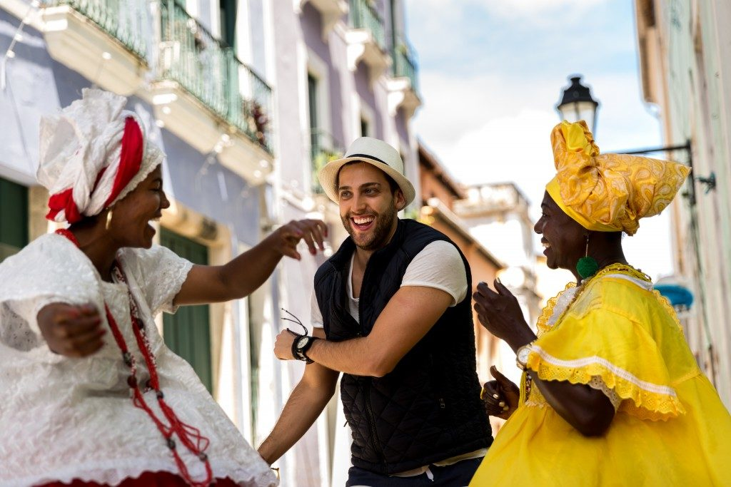 tourist dancing with locals
