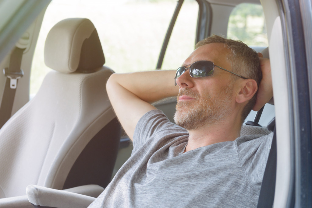 man relaxing in his car